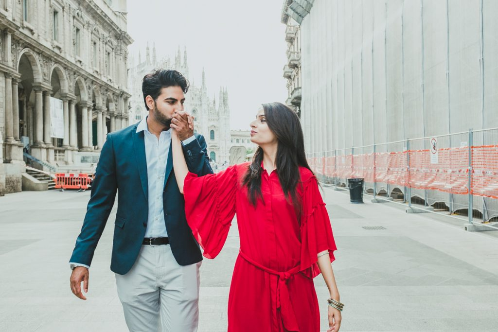 lovely couple walking in Milan during an engagement