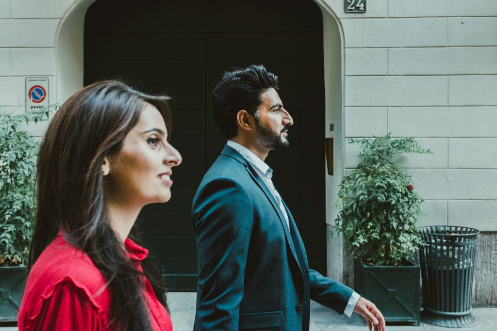 couple walking in Milan during an engagement