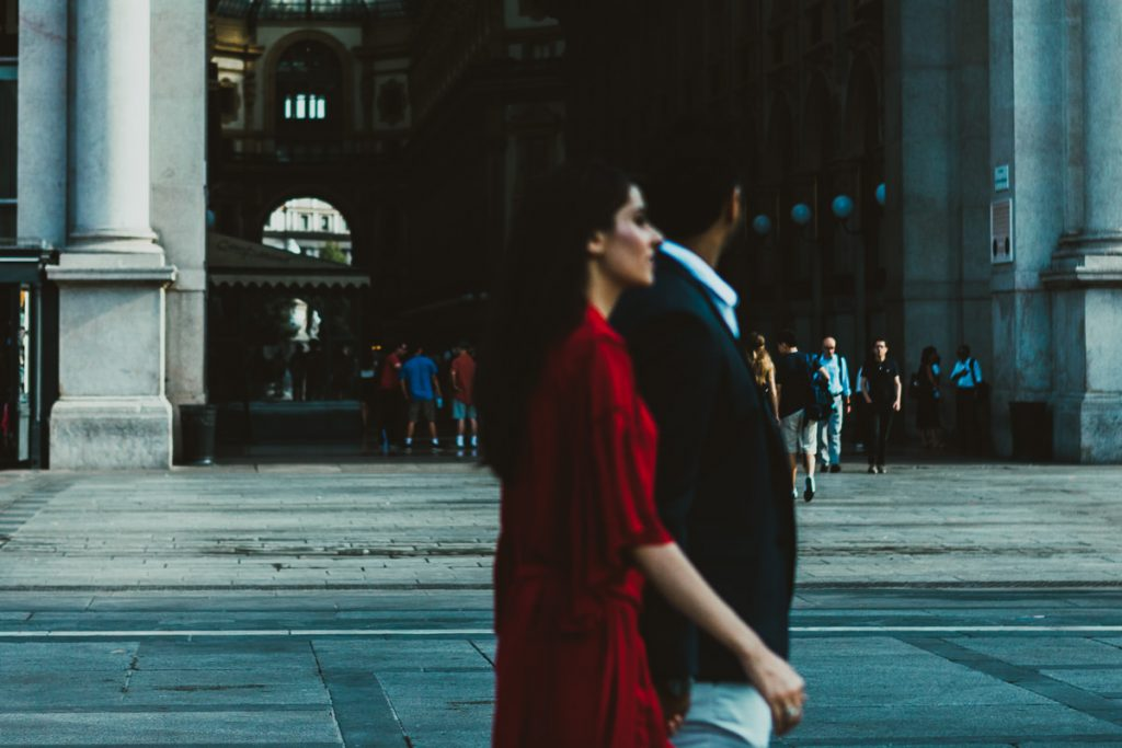 indian couple walking in Milan